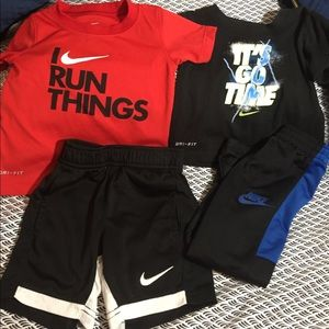 Nike 4 piece Bundle - Shirts Shorts Pants